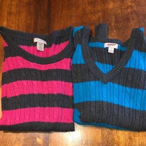 Two woman sweaters